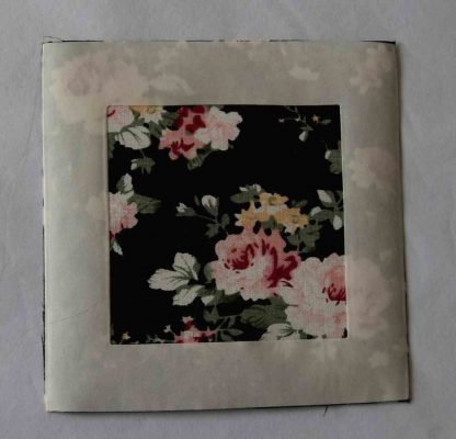 Vintage-Patch Jeans Reverse Repair Undercover Patch Black Pink Roses Print showing glue strip