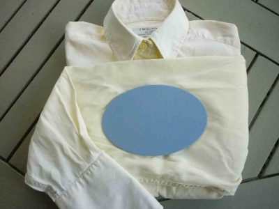 cream shirt with blue elbow patch