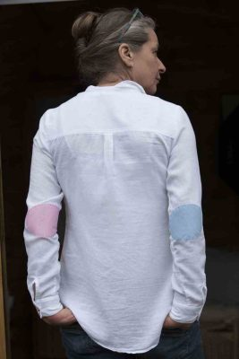 white shirt with mismatched elbow patches